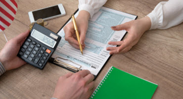 A tax preparer helps a client file their taxes