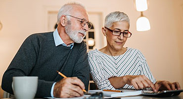 older couple doing taxes homepage